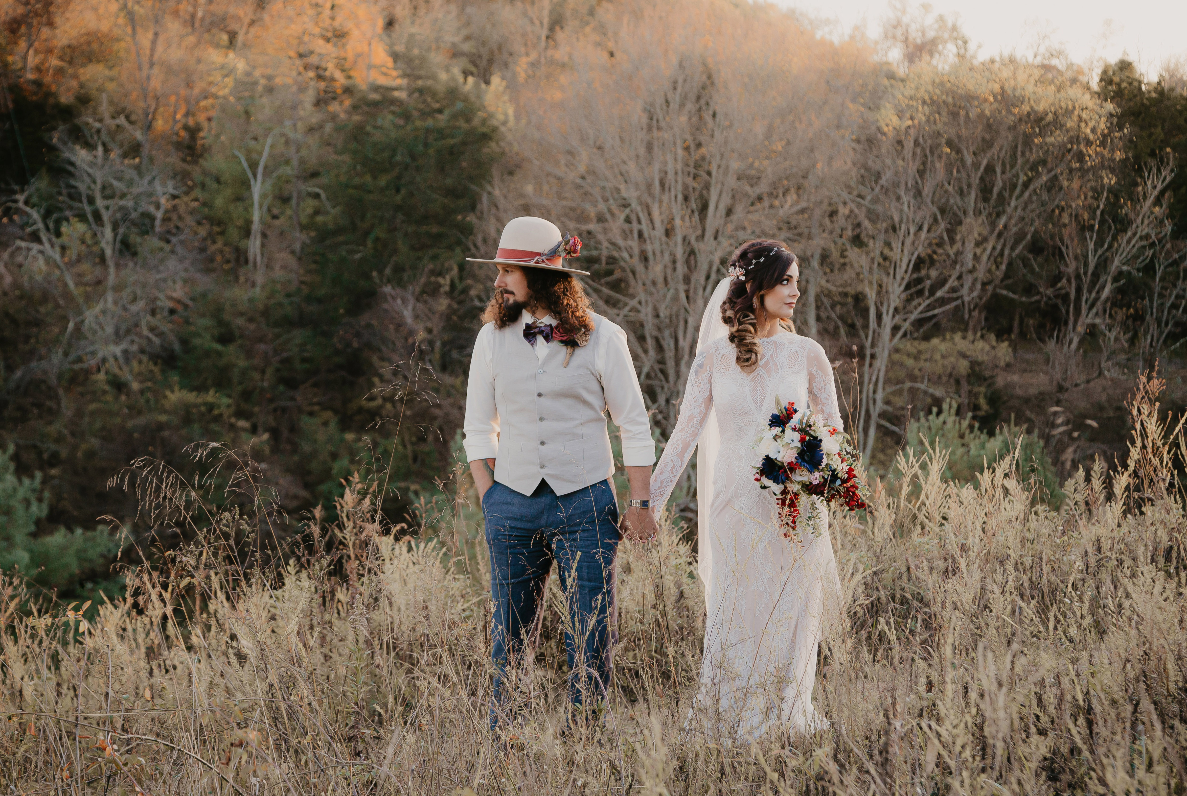 a couple walking through a field at flower mountains wedding venue in gatlinburg tennessee, this was their elopement