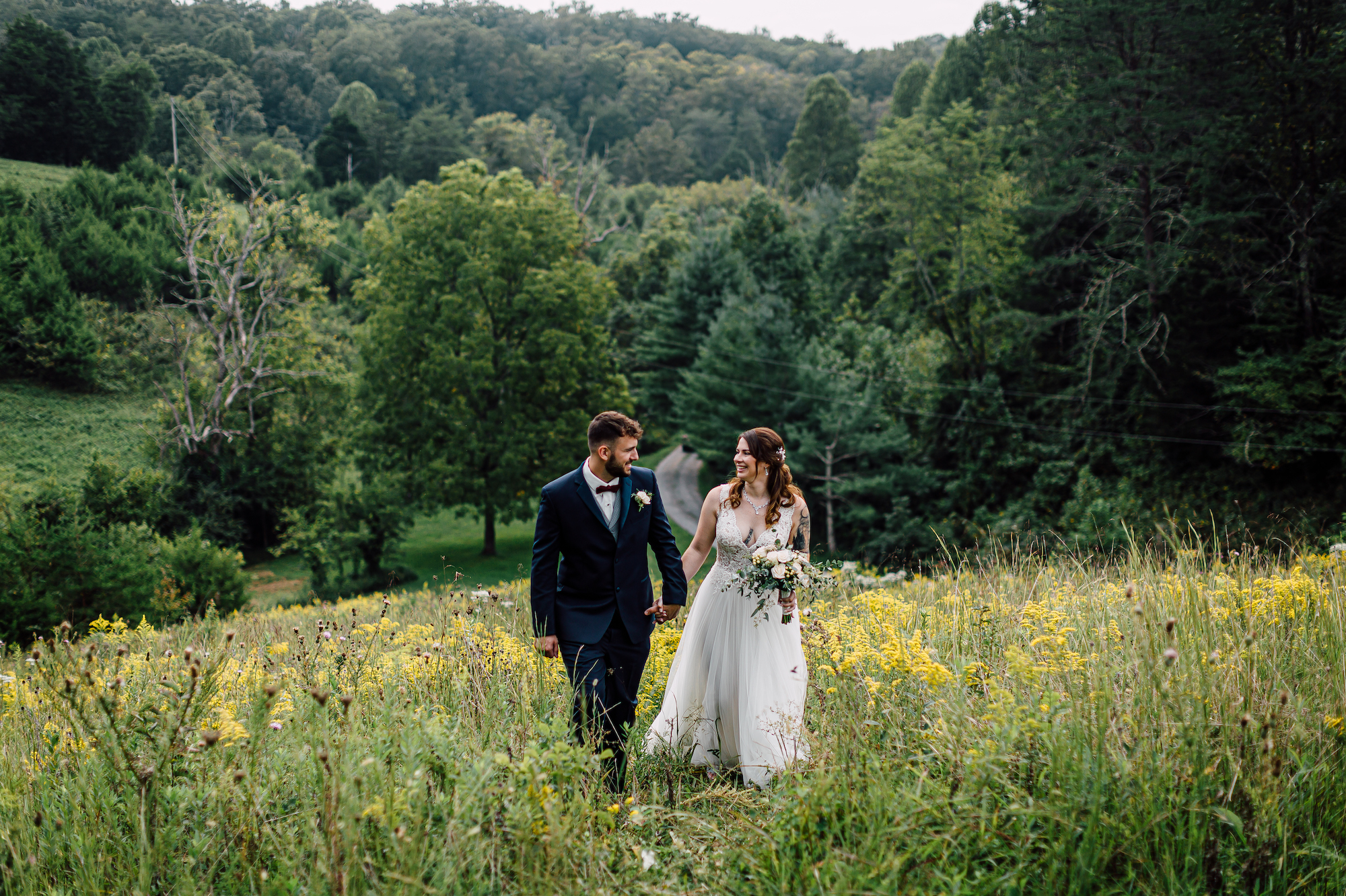 A couple in a field at flower mountain wedding venues in gatlinburg tennessee