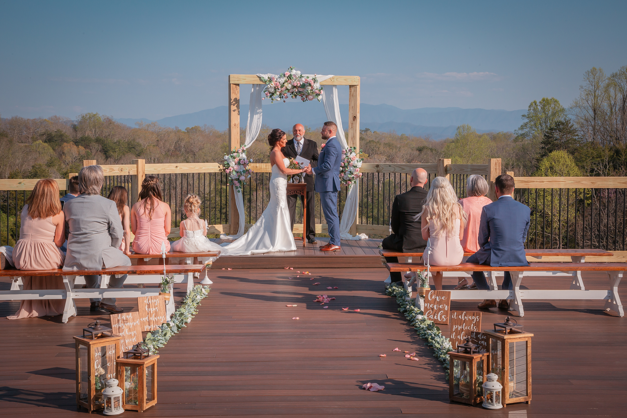 a couple getting married on the main porch where people get married at flower mountain wedding venues in gatlinburg tennessee