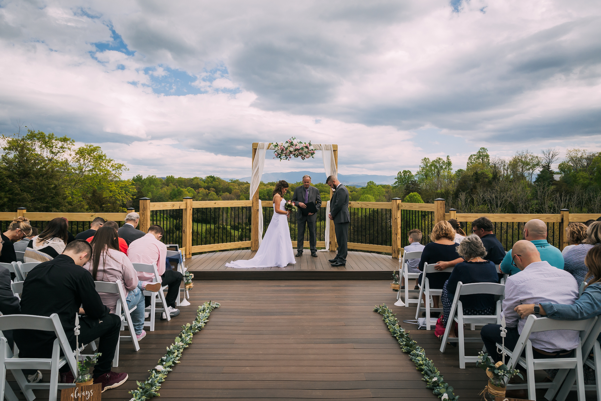 A couple getting married at flower mountain wedding venue