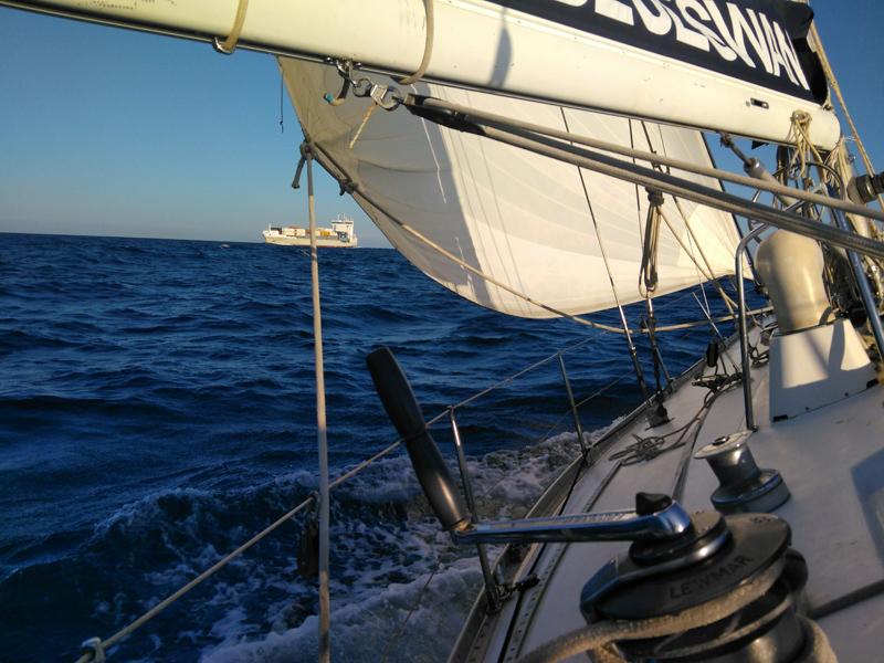 Heeling sailboat on open seas