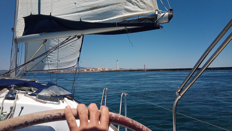 Captain at the helm on Swan 411