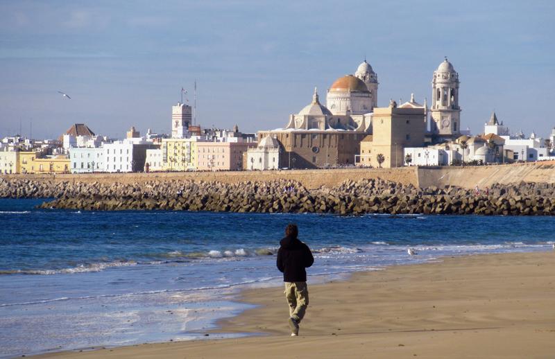 Man walking the beach of rota