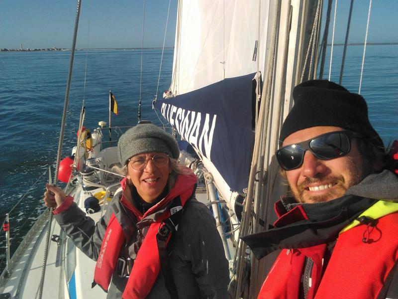 Skipper and crew onboard a Swan 411