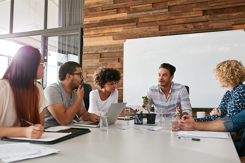 Group of young business professionals having a meeting