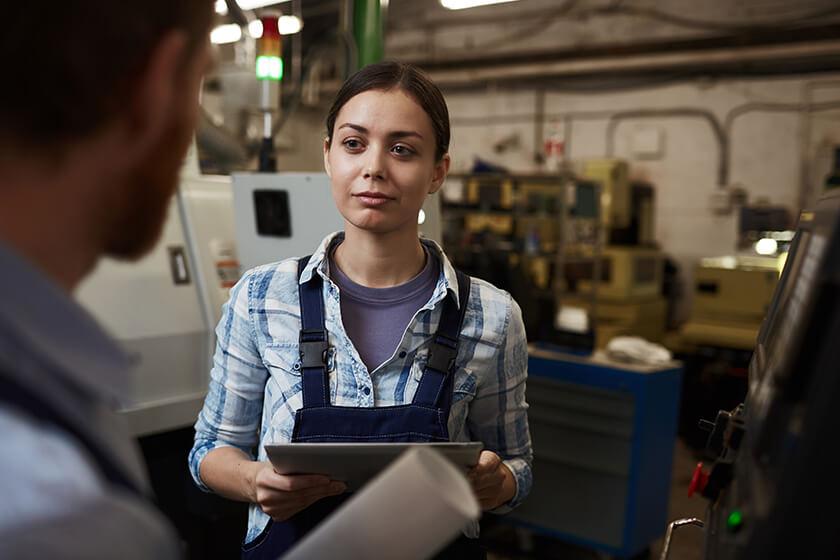 Businesswoman talking to co-worker