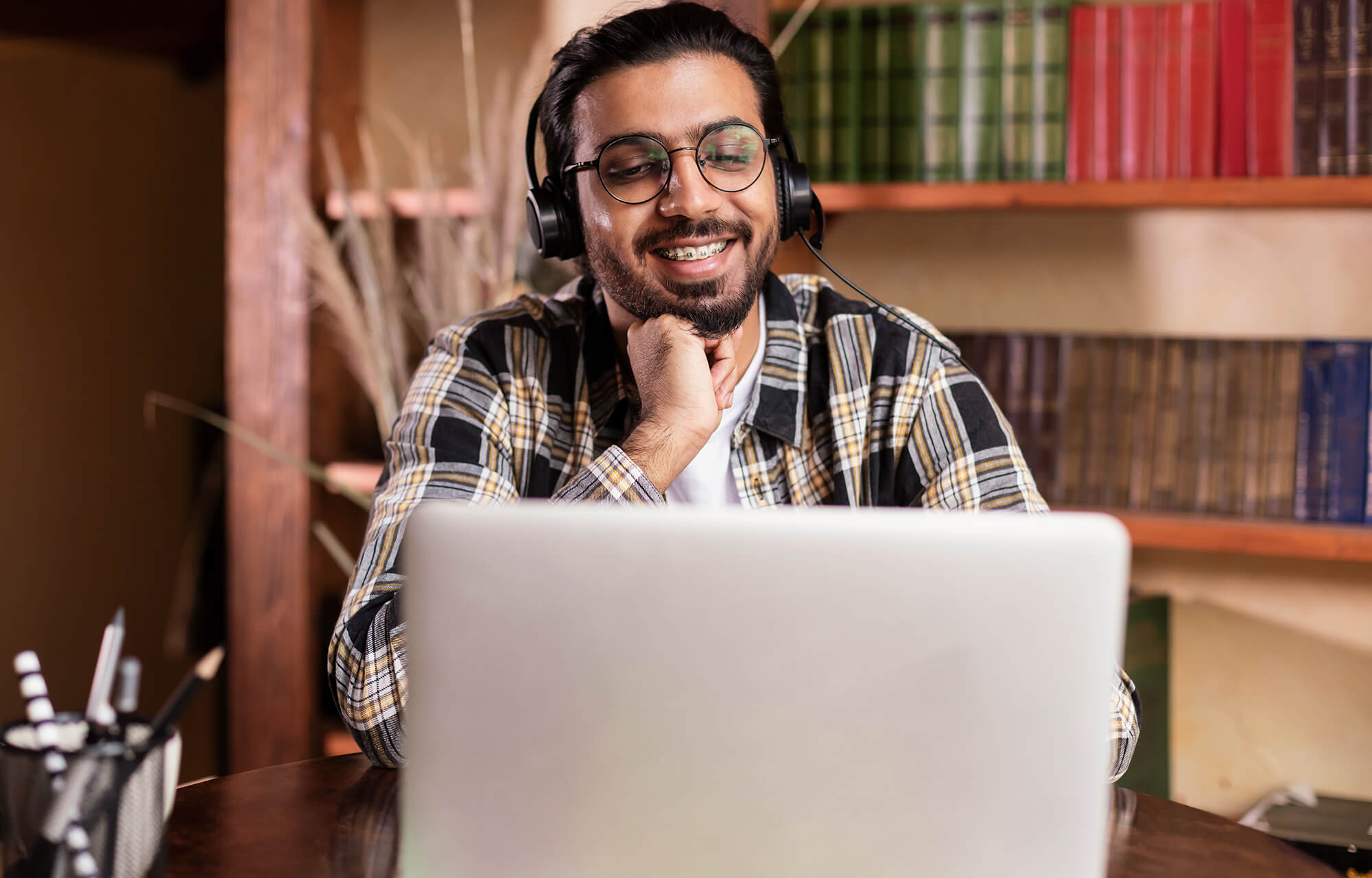 student guy watching video lecture online on laptop