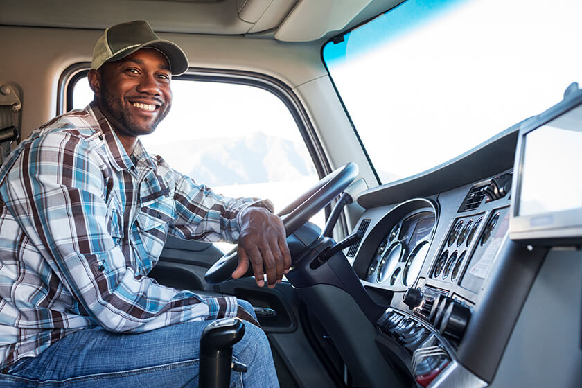 Truck driver in the cab of his commercial truck