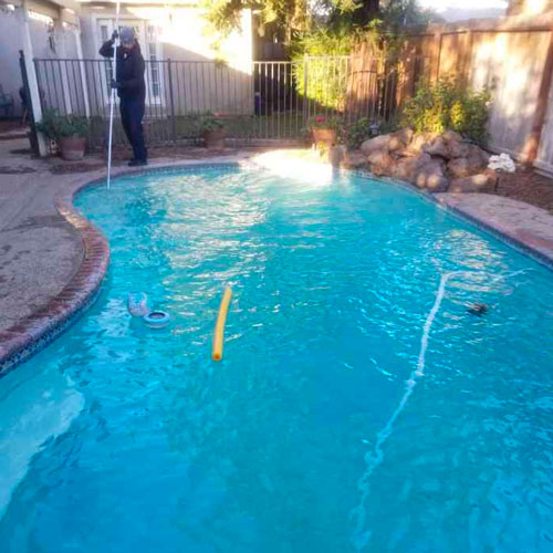 Pool Fresh cleaning a residential pool in Atwater Area, CA.