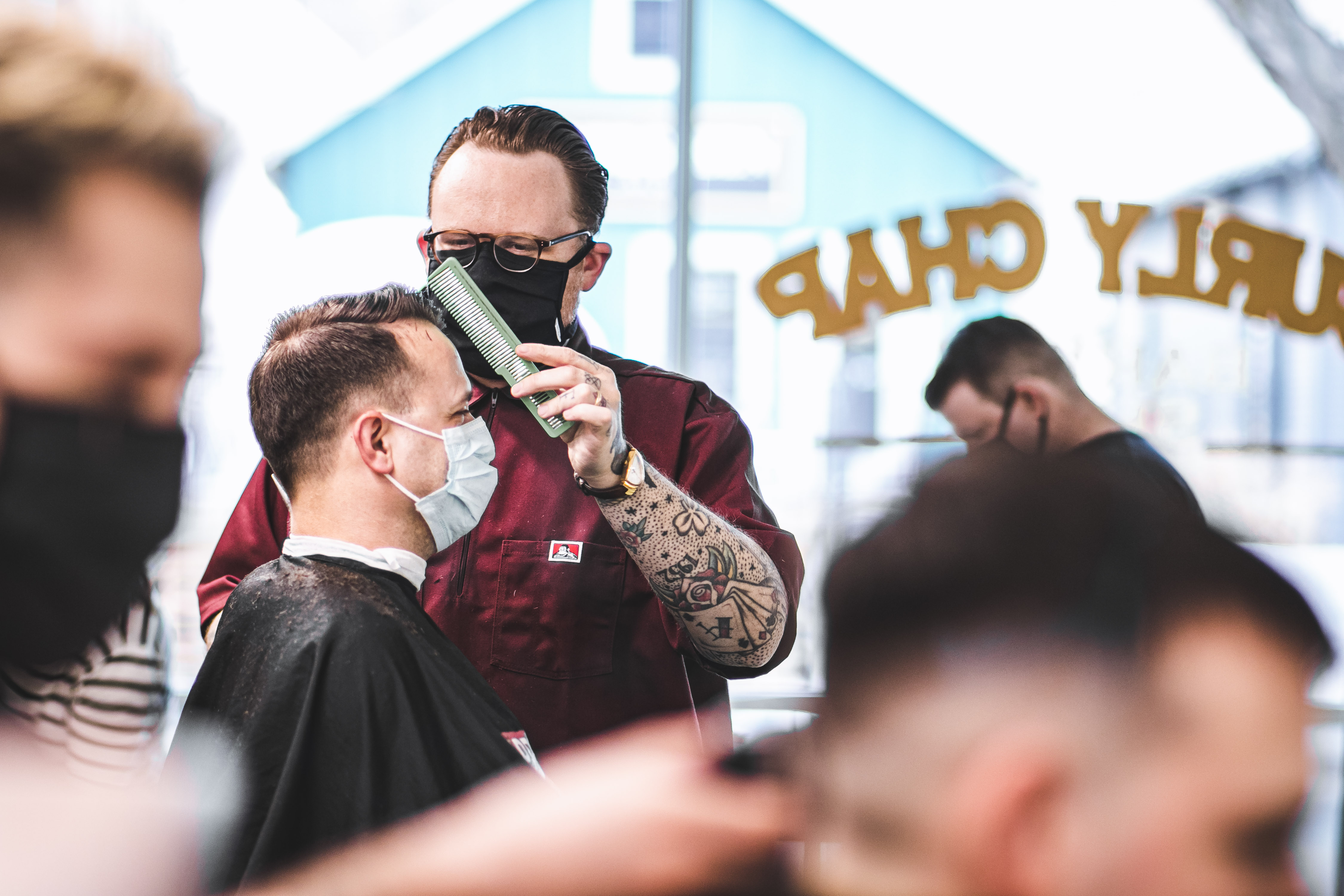 Photo of the owner Lew cutting a customer's hair