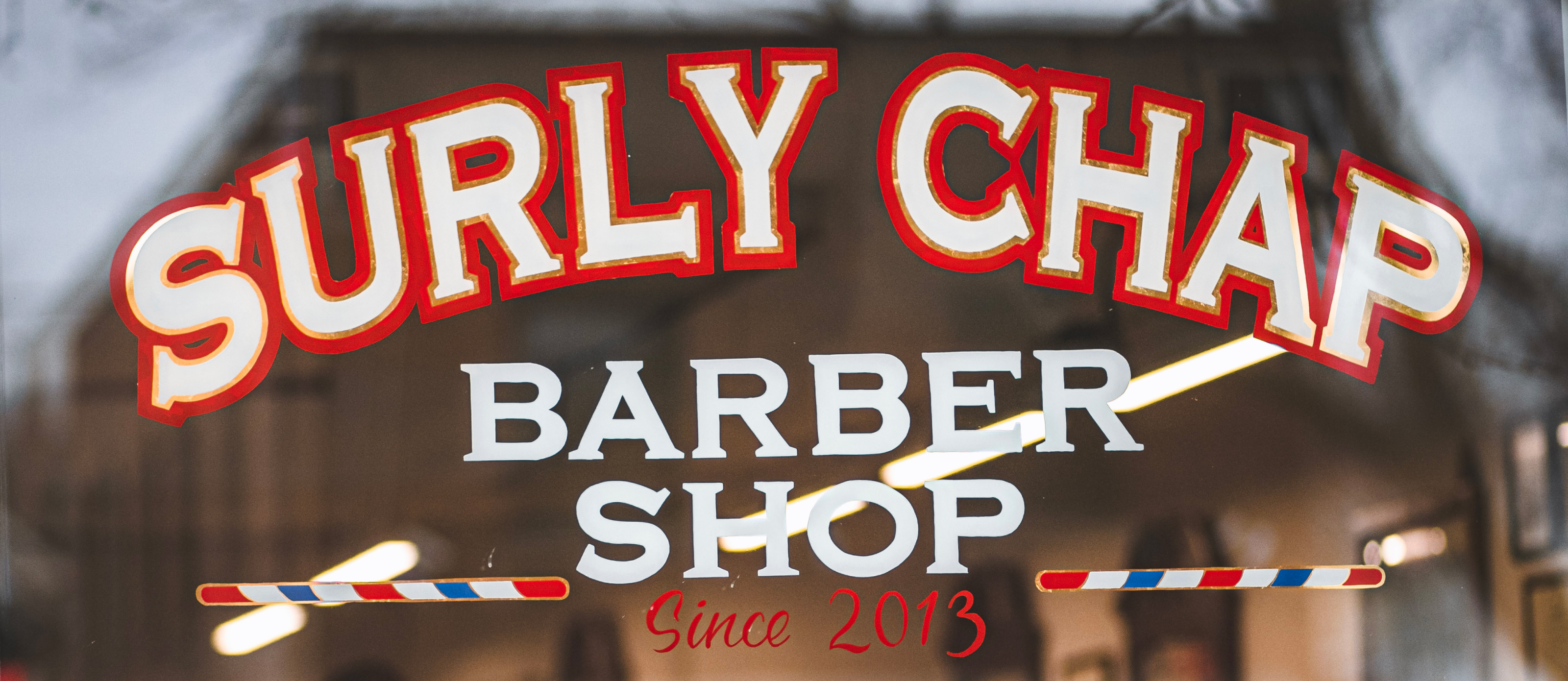 Photo of the Surly Chap window sign
