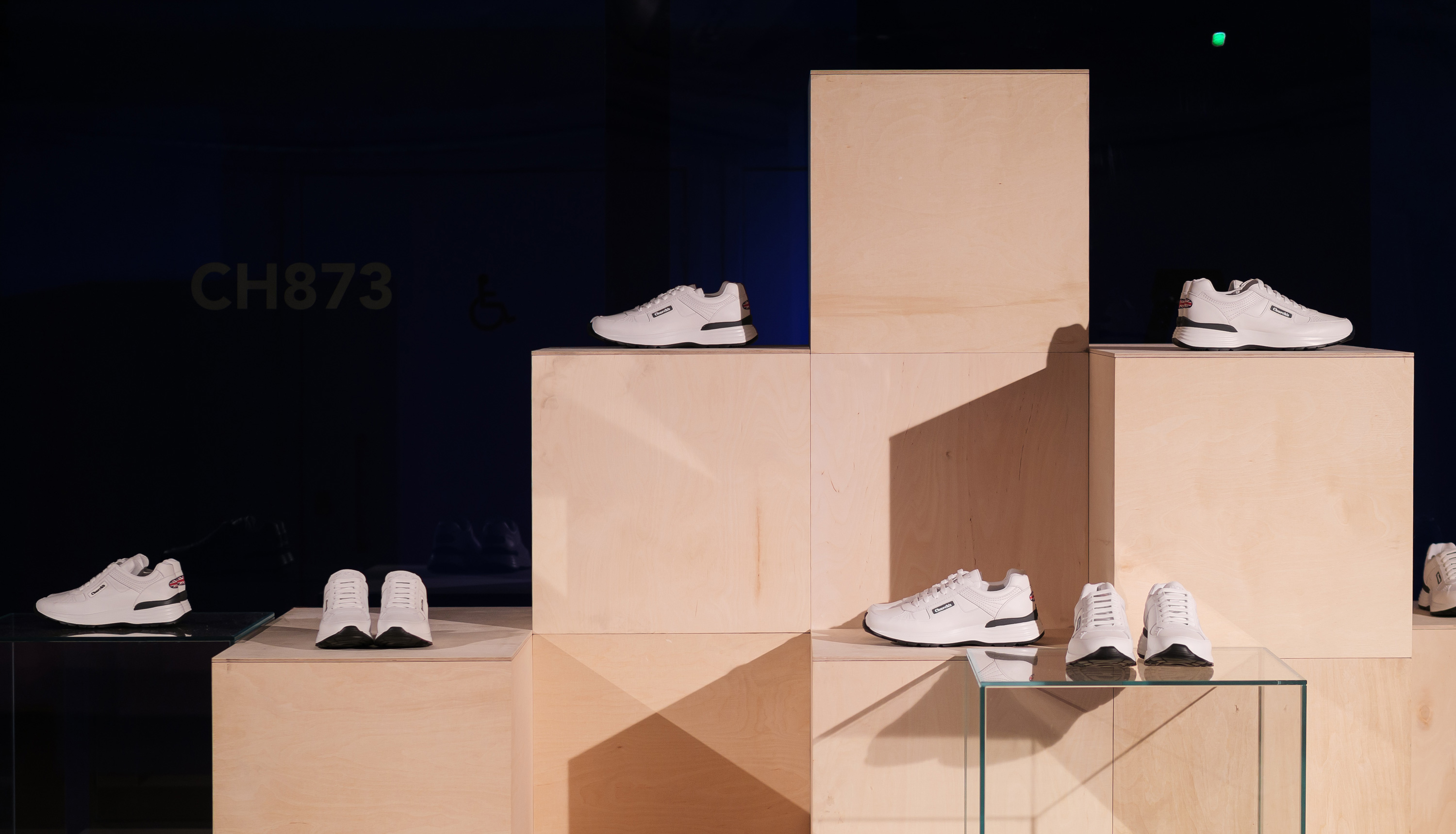 Display of shoes that are nicely placed on wooden boxes