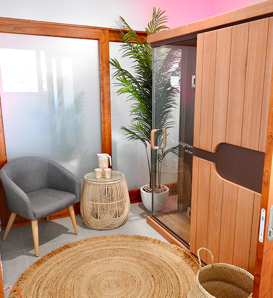 Image of mPulse sauna in the sauna room with plants, chair and little table to relax