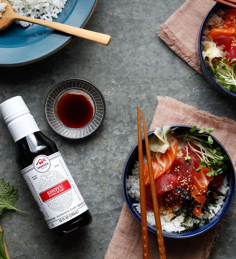 Image of a finished meal called Zuke-don beside a bottle of Yamasa Shoyu Sauce.