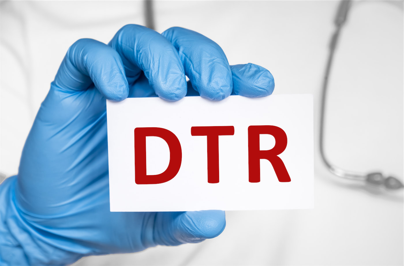 doctor holding card that says DTR