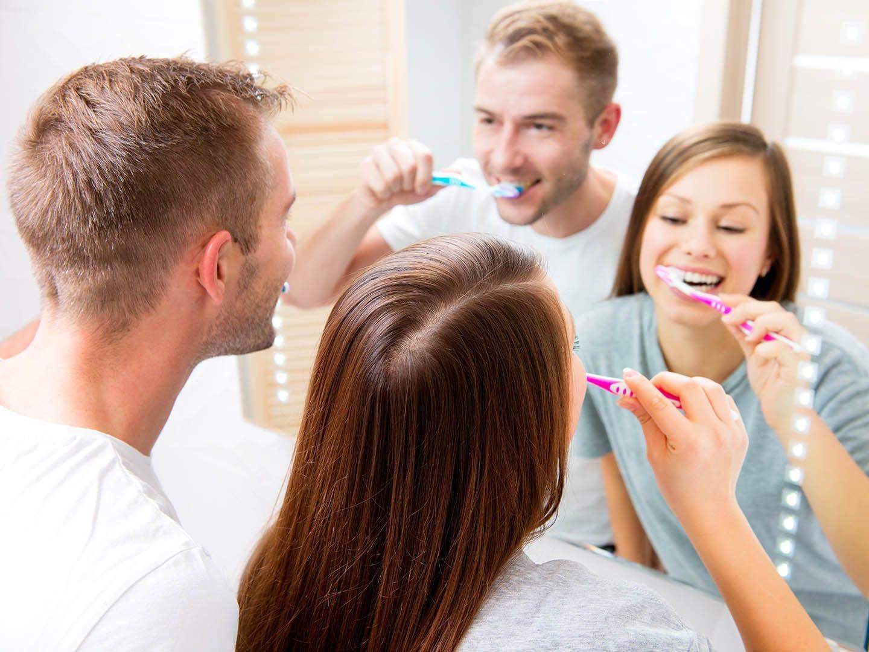 couple brushing their teeth