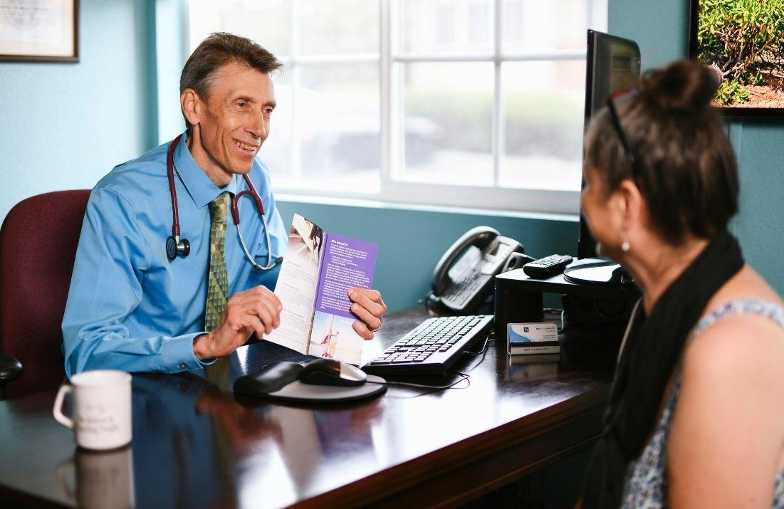 Dr. LaBeau talking to a patient