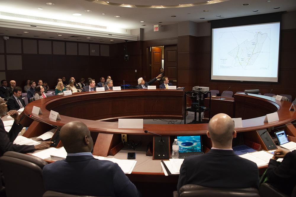 Board and advisory members present data findings.