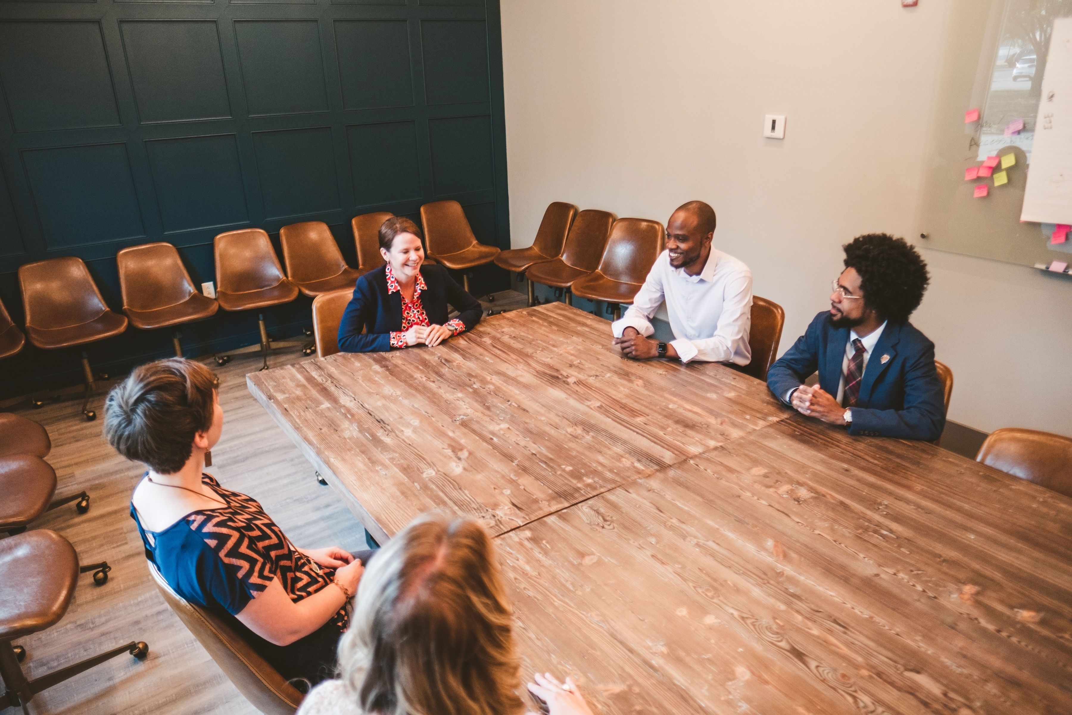 Group image of several CFGC staff in the boardroom.