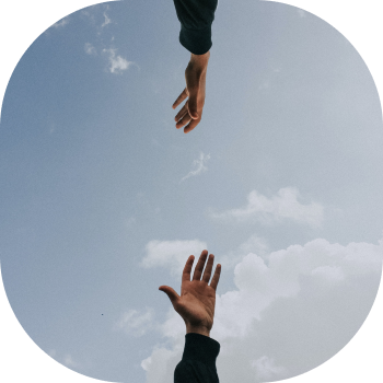 Two hands reaching for eachother