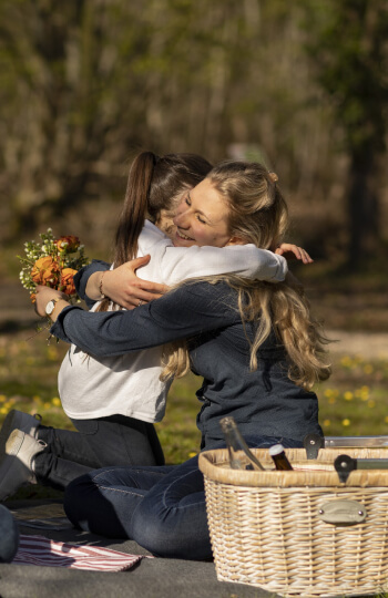 woman hugging kid