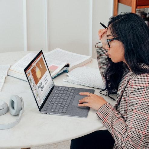 Venture Capitalist - Women sat at desk with computer