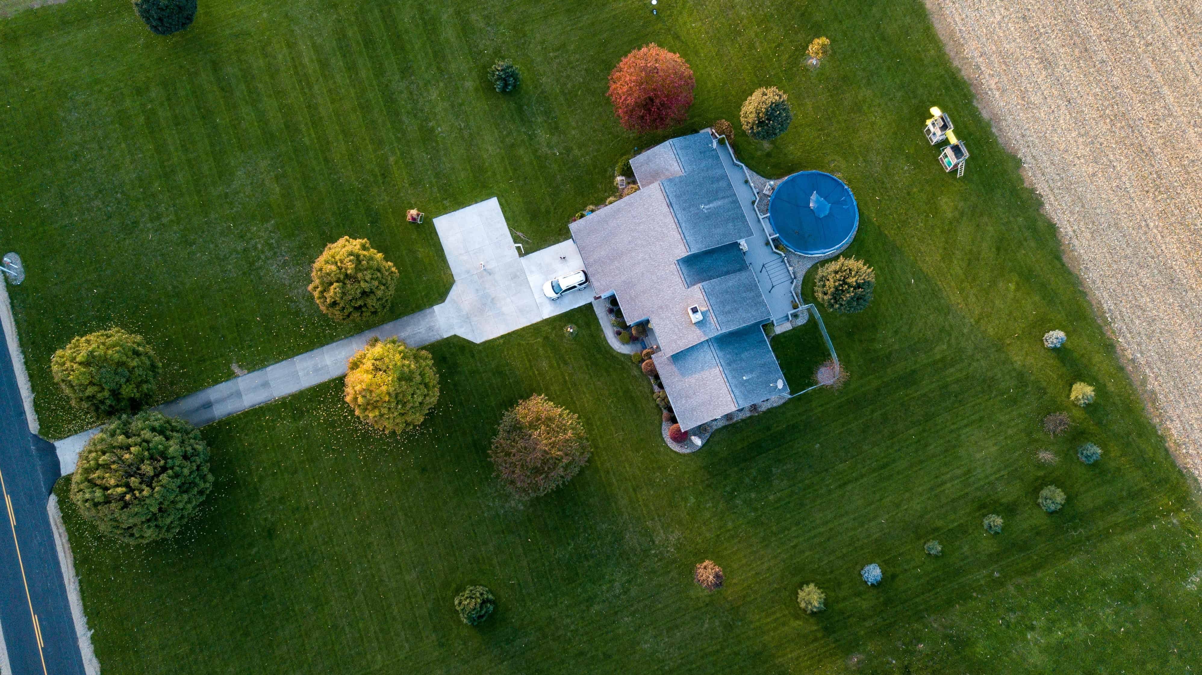 Aerial view of large property with freshly manicured lawn