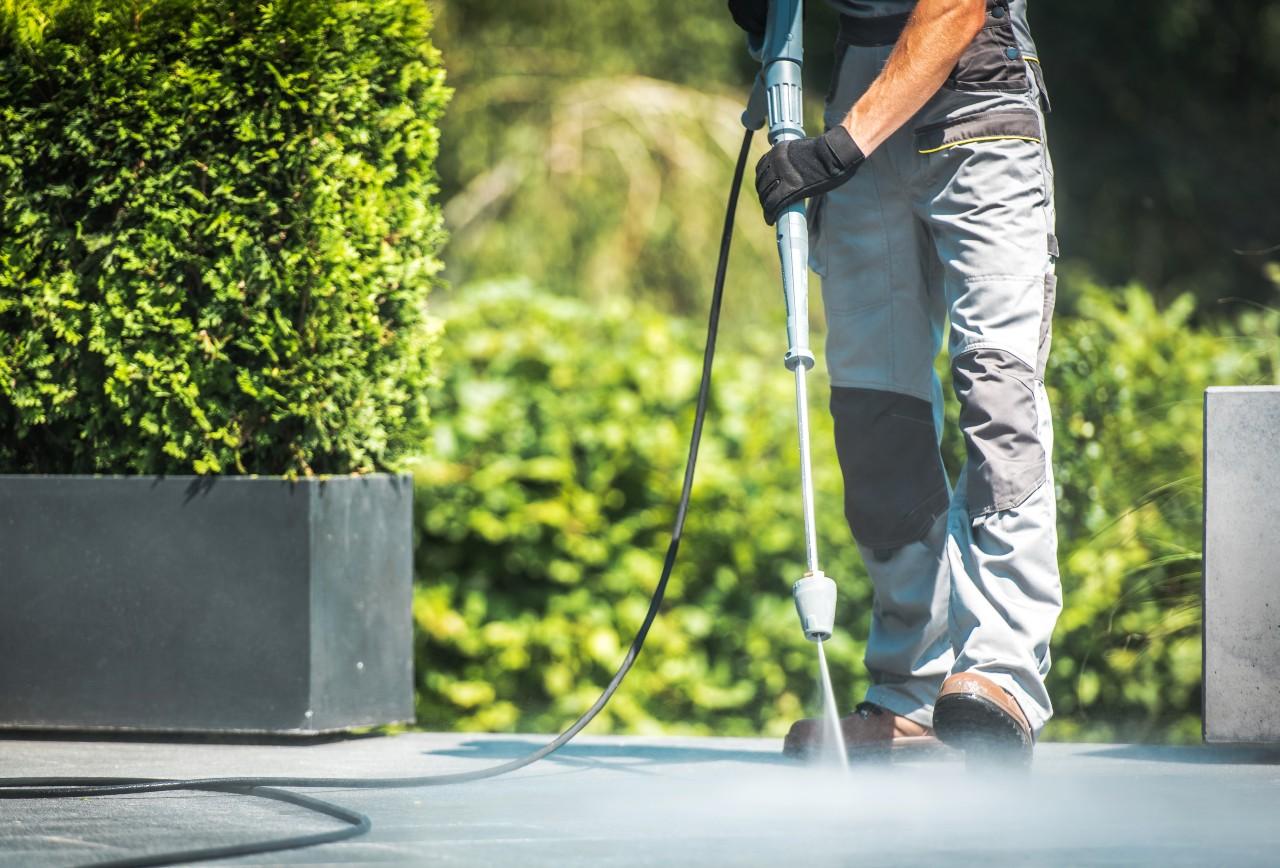 Professional pressure washing a driveway