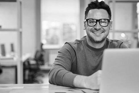Man using his laptop smiling