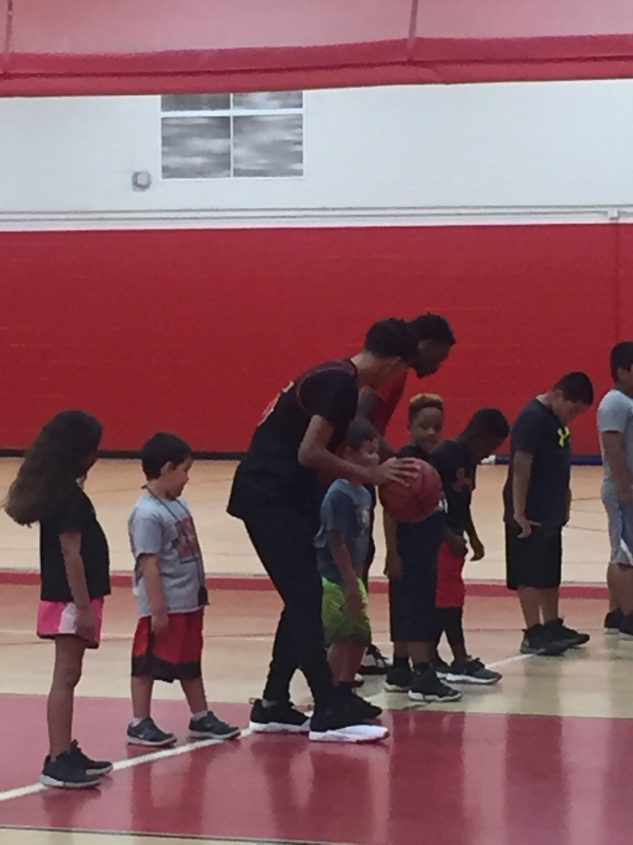 Young kids learning to play basketball