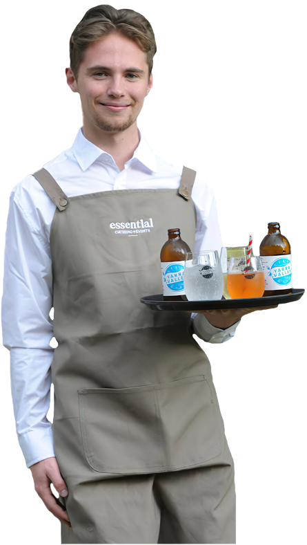 An Essential Catering employee serving drinks