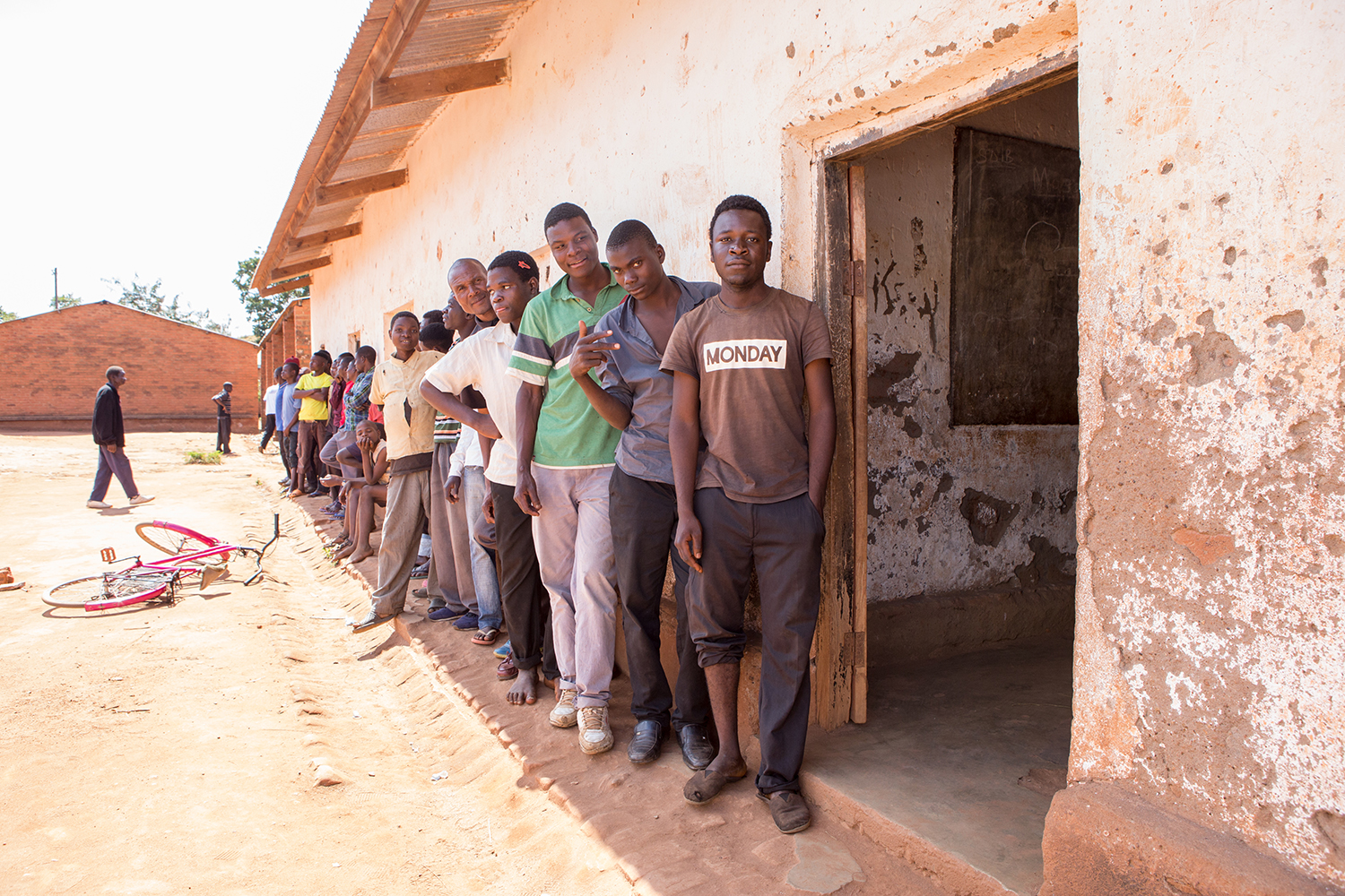 Men lining up for health care malawi