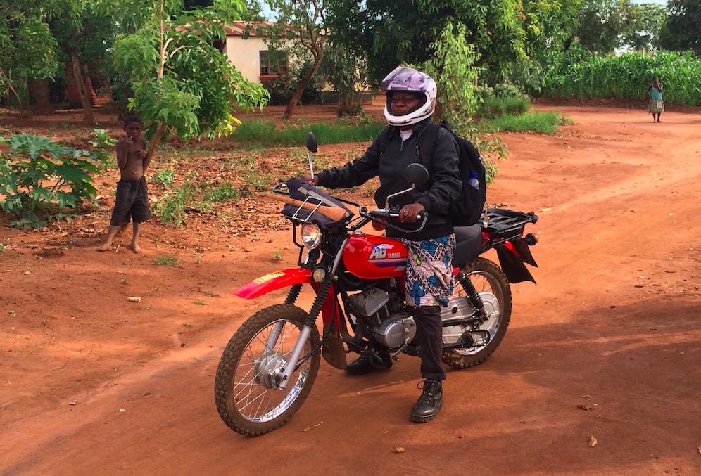 Malawian woman riding motorbike