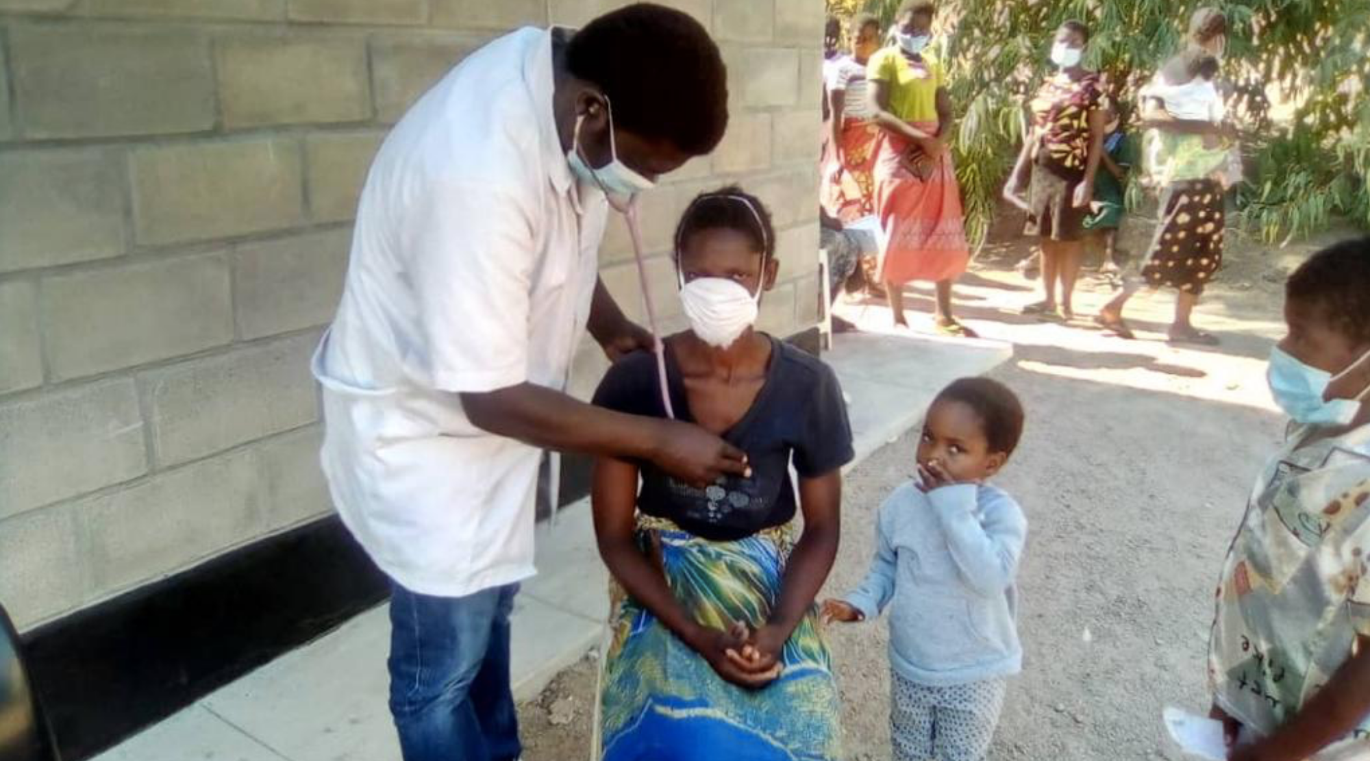 Malawian health care worker provides comprehensive medical care to rural villager of southern Malawi who, normally, would need to travel far to seek care at the nearest government health facility.