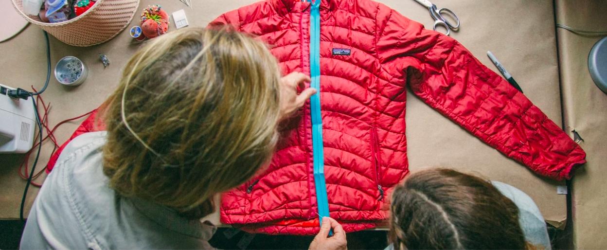 patagonia blog photo of two ladies measuring a jacket