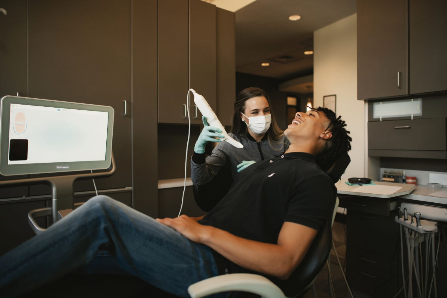 Photo of a Gilday team member taking a digital impression of a patient