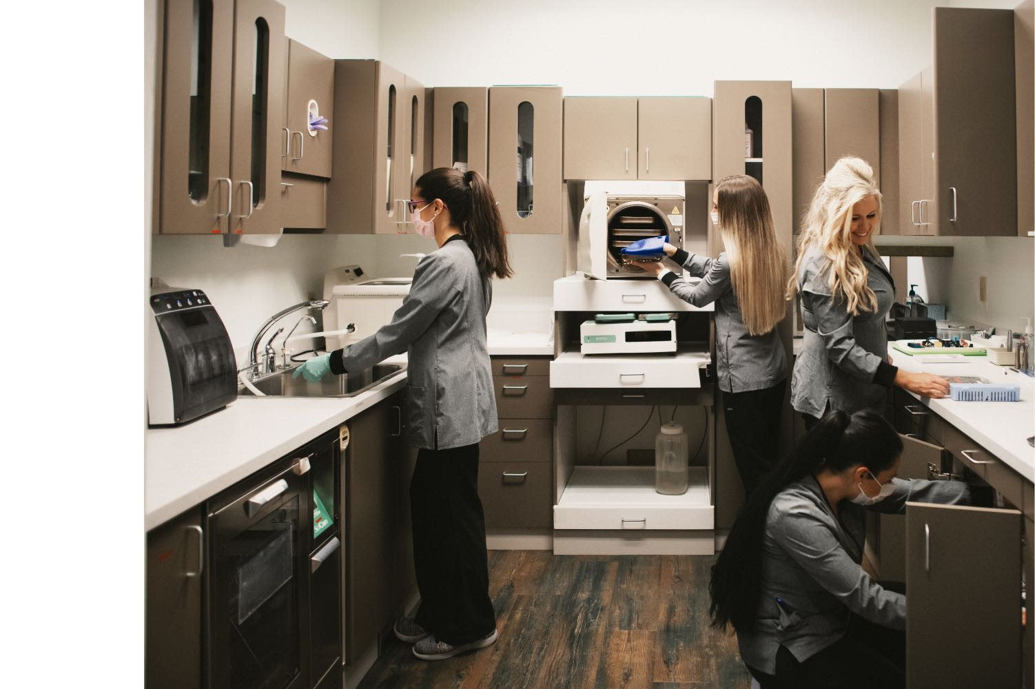 Photo of Gilday team members working together in the Gilday in-house lab
