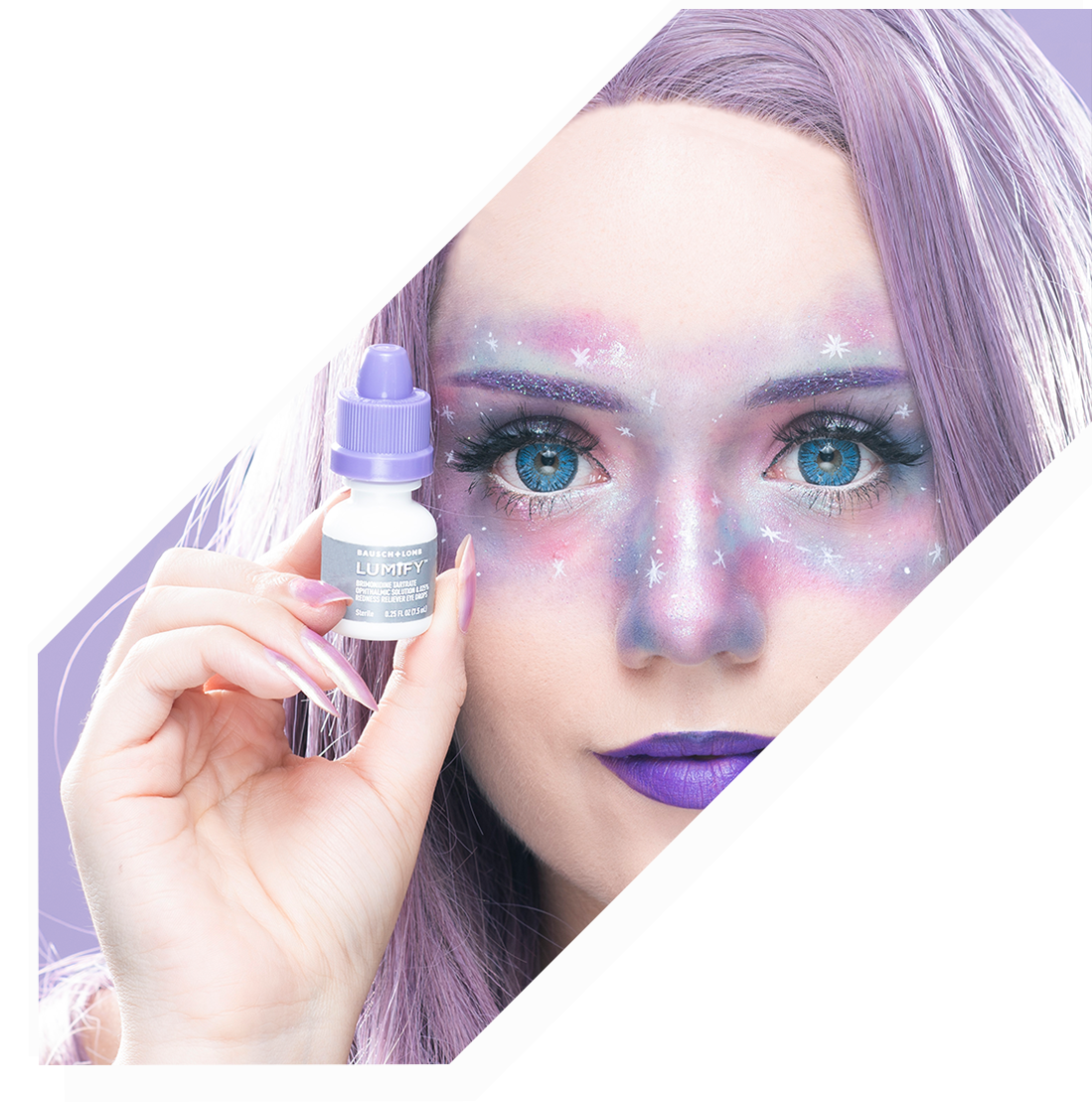 Close up of a girl in a purple wig with purple starry makeup on holding a bottle of Lumify Eye Redness Relief drops
