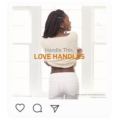 """A back view of a woman slightly lifting her cream sweater showing her waist. Captioned """"Handle this, love handles"""""""