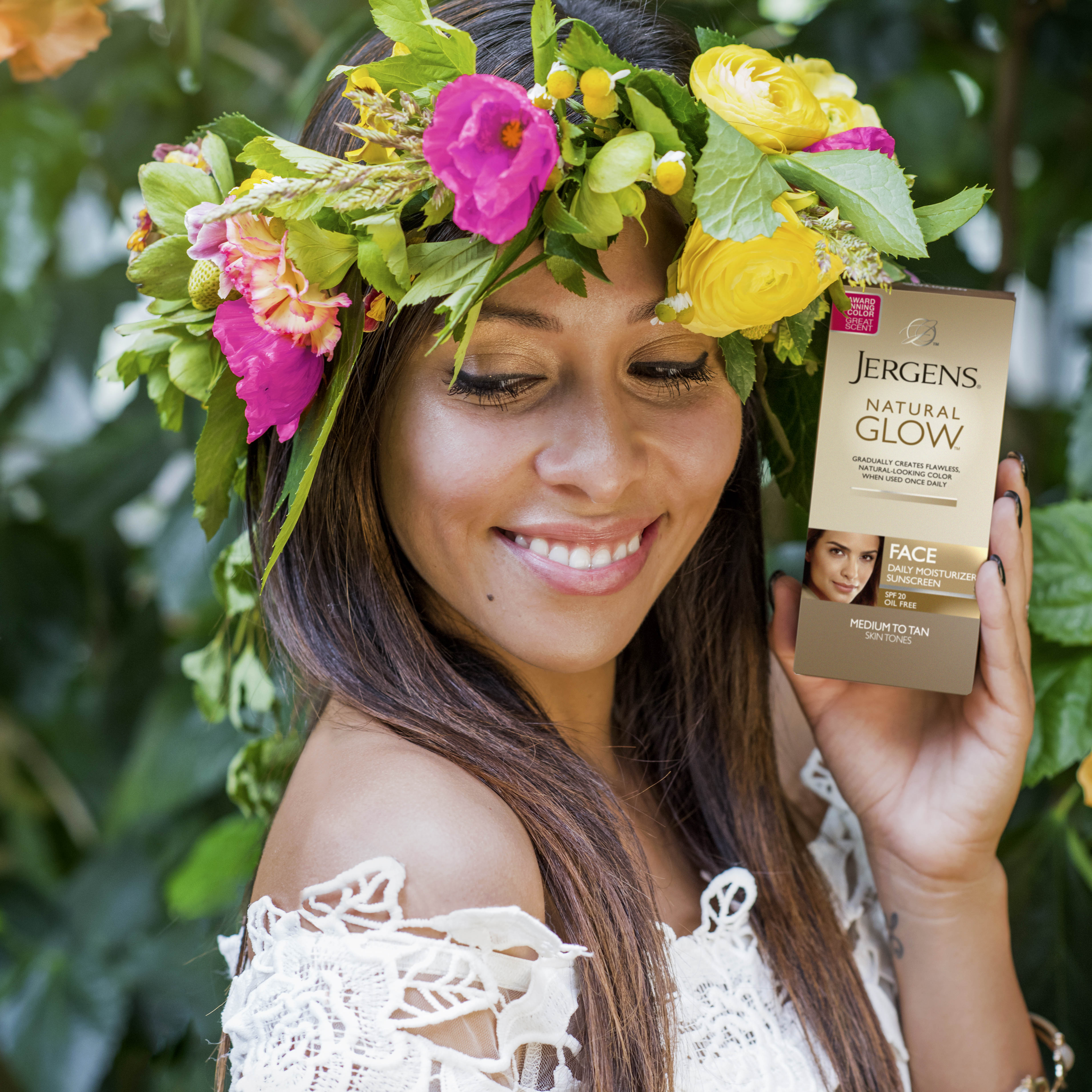Model with floral headpiece holding Jergens Face Tanner