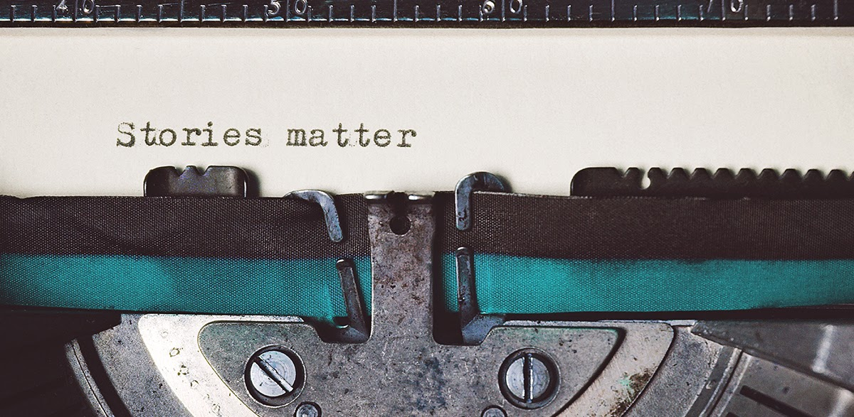 "Typewriter with text on page reading ""Stories matter"""