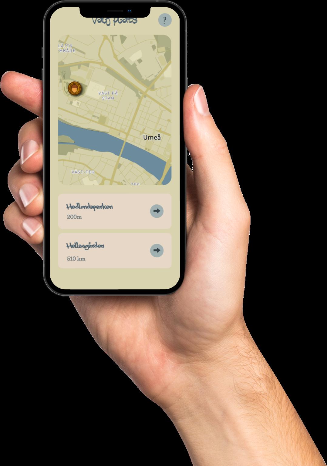 Hand med mobiltelefon och Run and Find Oknytt-spelet