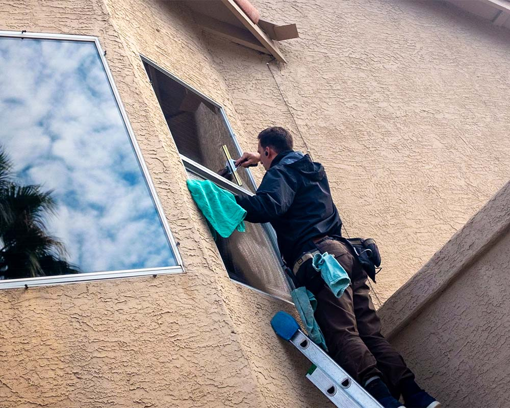 Window cleaning on ladder in Ahwatukee