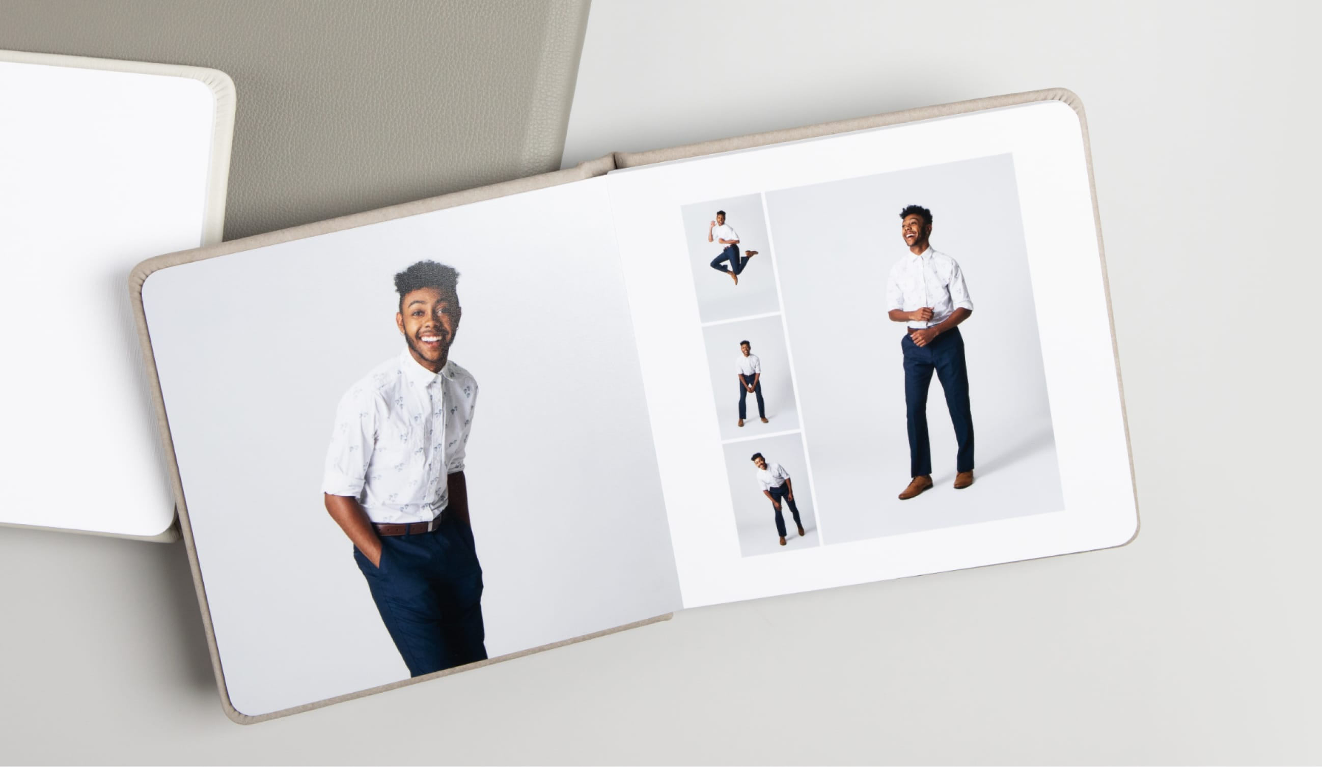 Open book with rounded edges with a picture of a senior graduate boy.