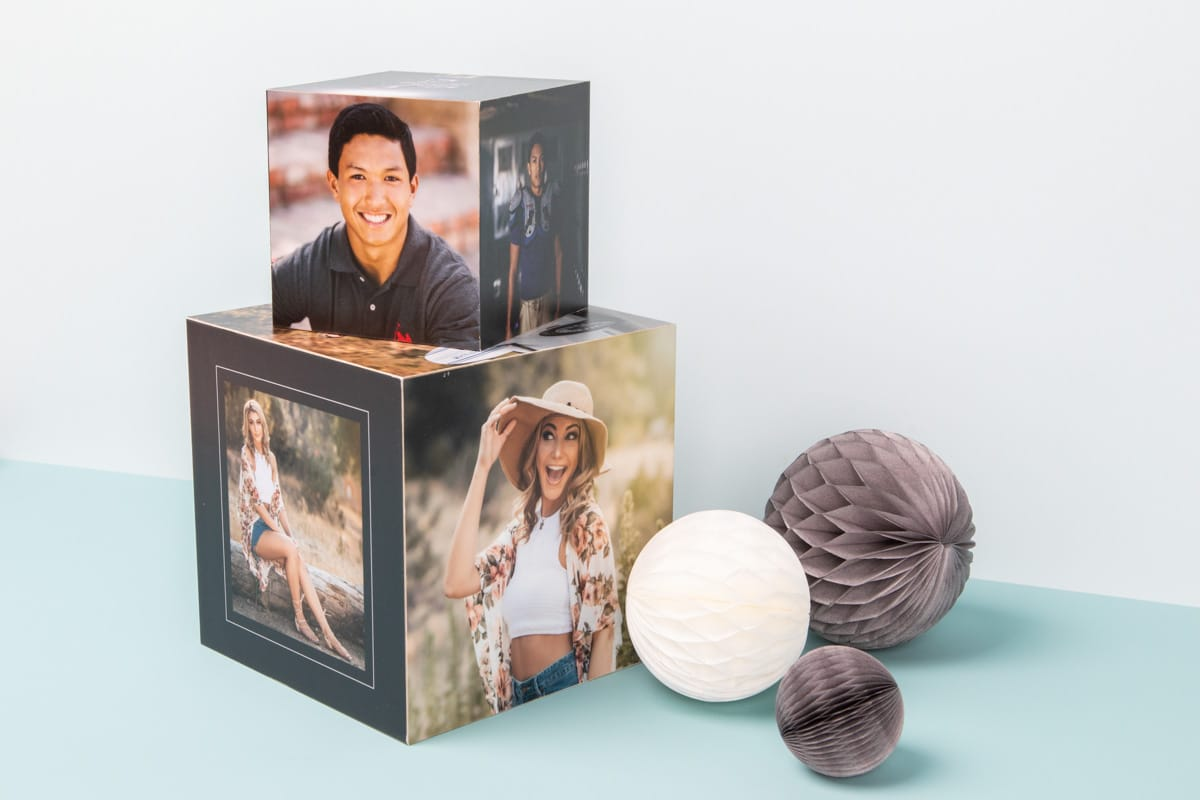Two image cubes with photos of senior graduates stacked on top of each other.