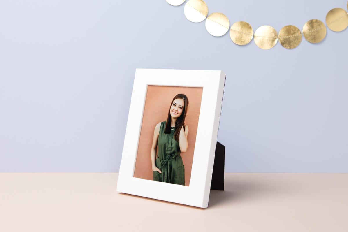 Small White Framed Print of senior graduate girl.
