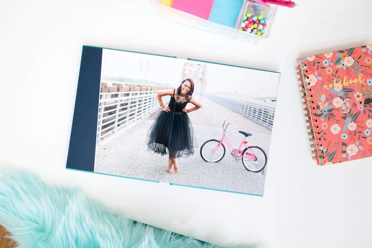 Open album with full spread page of senior graduate girl.