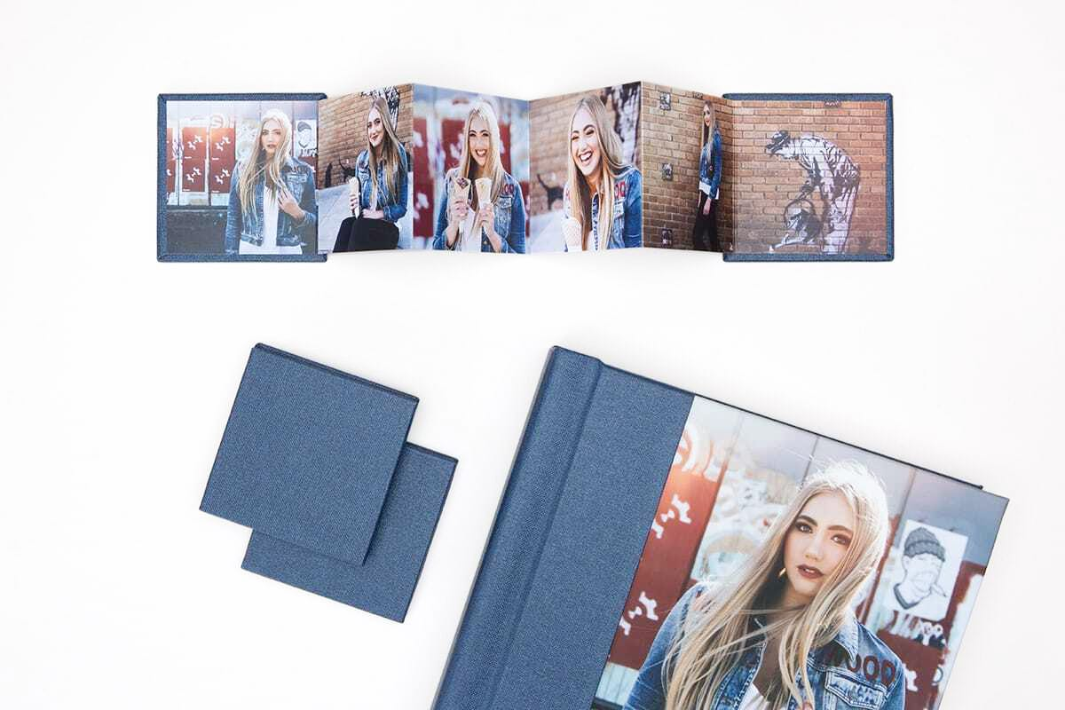 Mini Book opened up with photos of senior graduate girl.