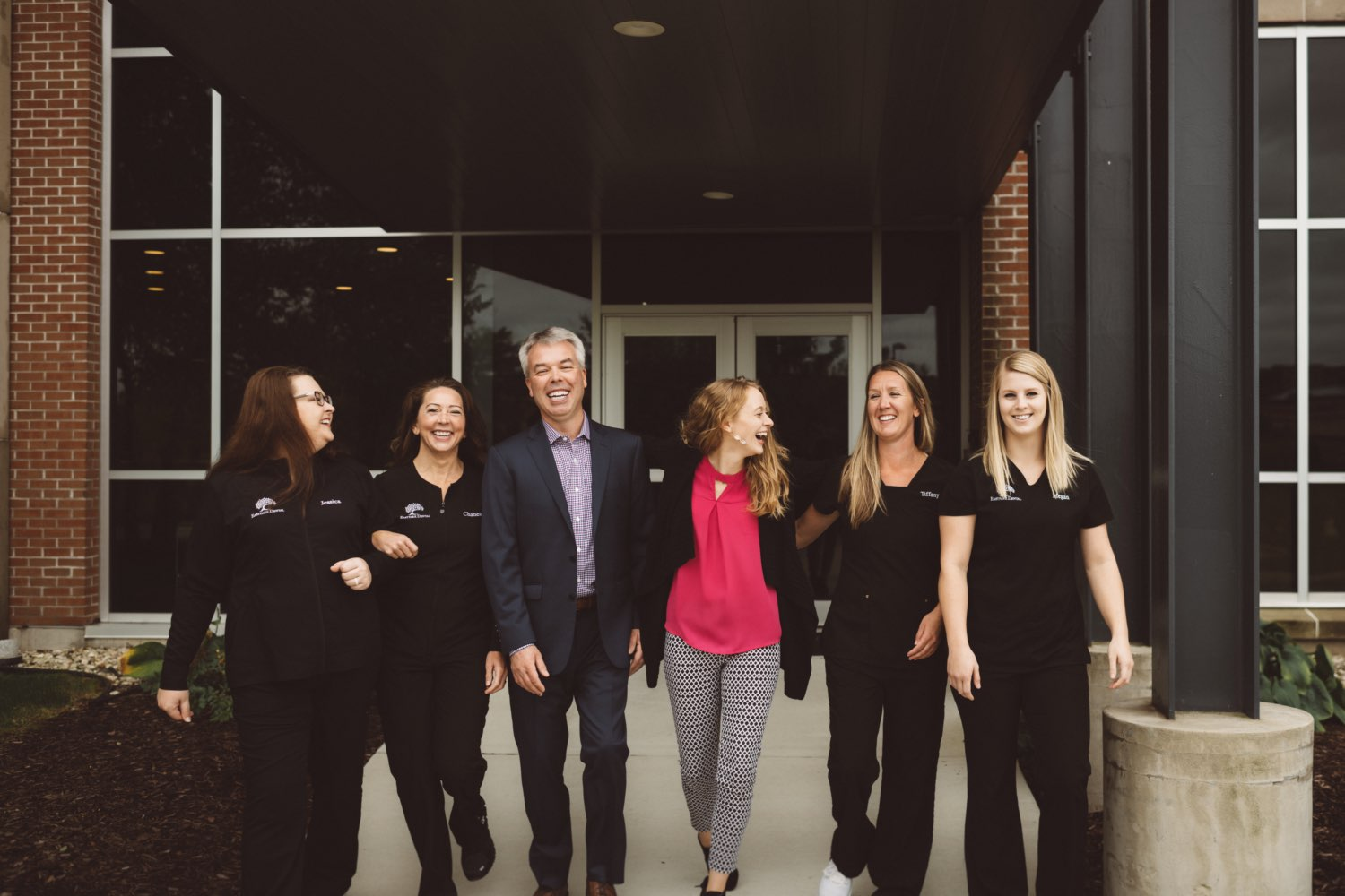 Photo of the Eastpark Dental team in front of the office smiling