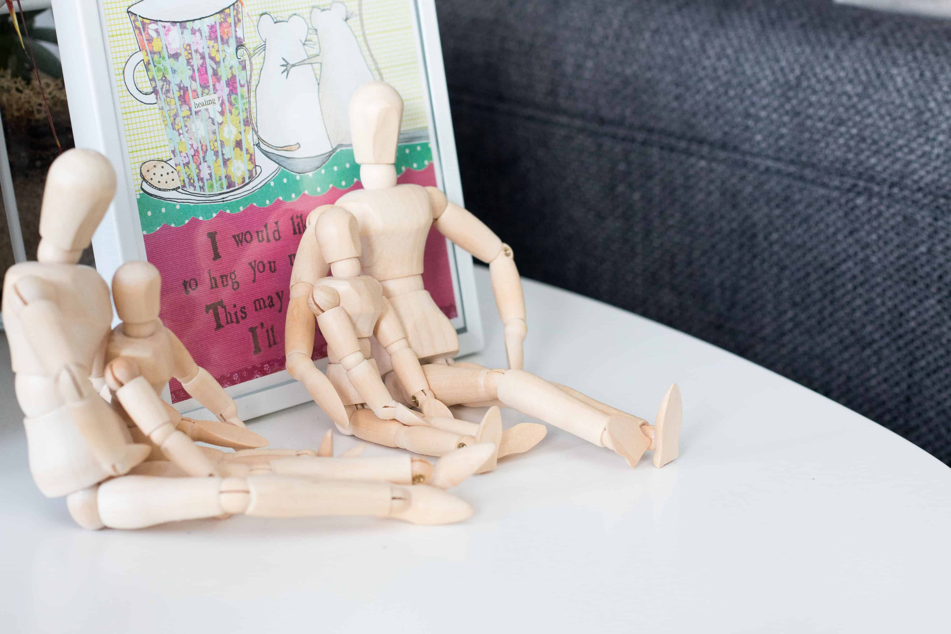 Family set of wooden doll figurines
